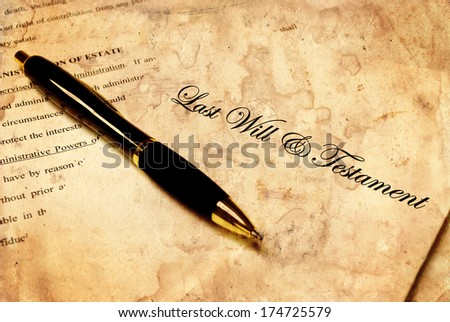 Pen laying on top of a Will for estate planning - stock photo