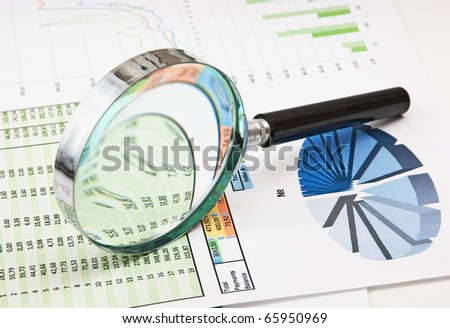 pen, magnifying glass and the working paper with a diagram - stock photo