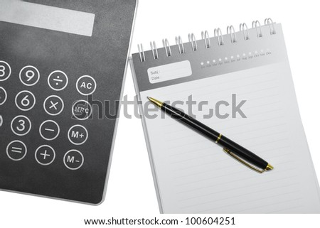Pen on a book and a Calculator on white background.