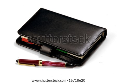 Pen on a closed personal diary - stock photo