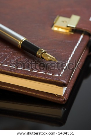 Pen on a personal diary - stock photo