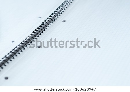 Pen on a white sheet. Macro image with shallow depth of focus.