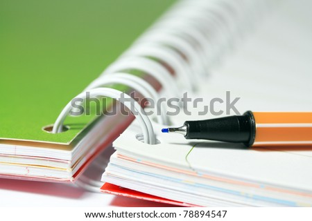 pen on blank note book - stock photo