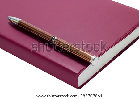 Pen on book isolated on white background.