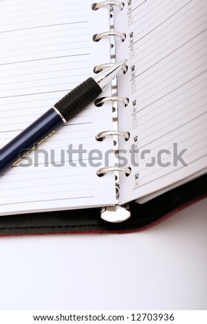 Pen on business notebook. Close-up - stock photo