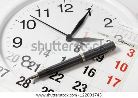 Pen on Calendar and Clock - stock photo