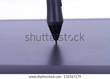 Pen on digital graphic tablet, isolated on white background. - stock photo