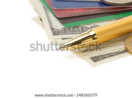 pen on dollar money banknotes isolated at white background