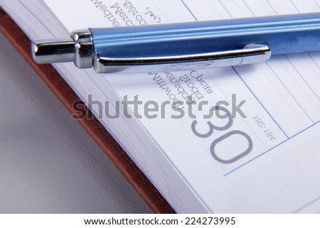 Pen on notebook - stock photo