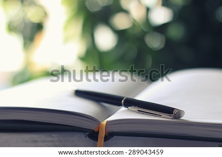 pen on notebook business - stock photo