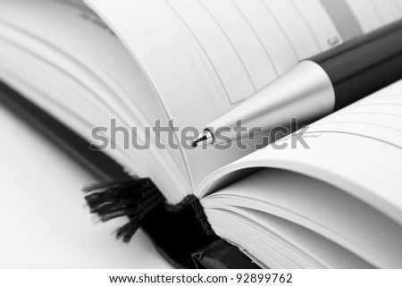 Pen on notebook organizer close-up - stock photo
