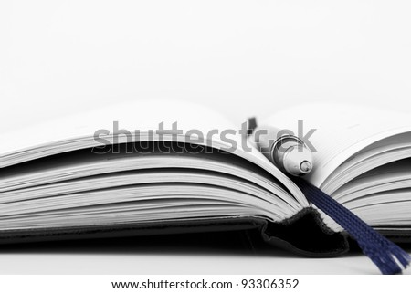 Pen on notebook organizer close-up - stock photo