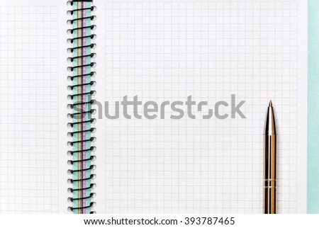 Pen on notepad. Close up - stock photo