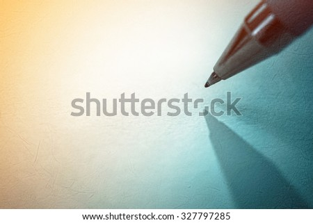 pen on old paper background - stock photo