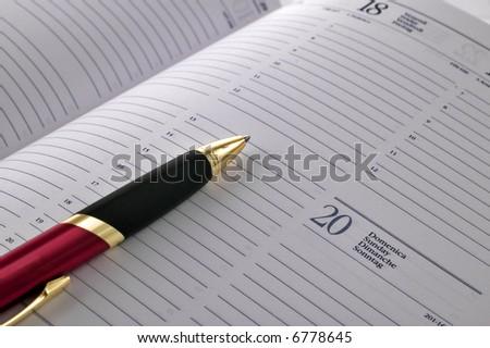 Pen on open agenda - stock photo