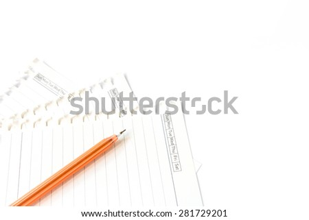 Pen on paper on white background. - stock photo