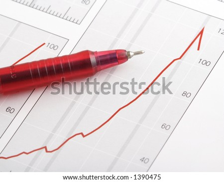 pen on positive earning chart(focus on the tip of the pen) - stock photo