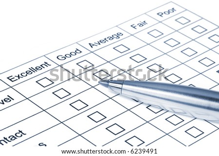 Pen on rating questionnaire.  Blue tone. - stock photo