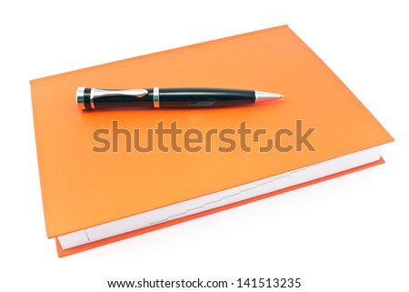 Pen on  red notebook isolated on white