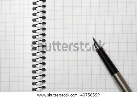 pen on the background of notebooks
