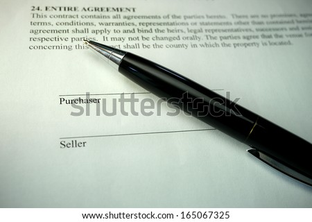 pen on the bottom of a legal document for buying a house