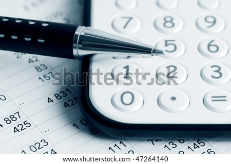 Pen on the calculator. - stock photo