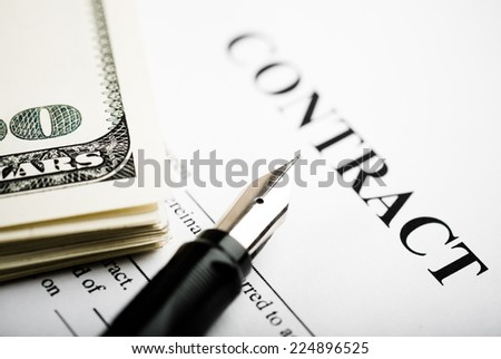 Pen on the contract papers and us dollars - stock photo