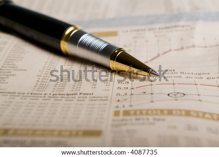 pen over data on a financial  newspaper