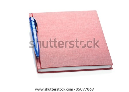 pen over red diary