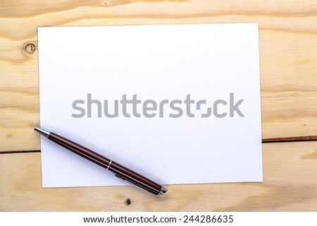 pen over white paper page - stock photo