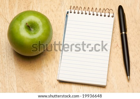 Pen, Paper and Apple on a Wood Background - stock photo