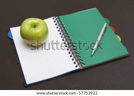 Pen, Paper and Apple on a Wood Background