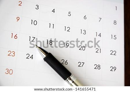 pen point to date seventeen on calendar - stock photo