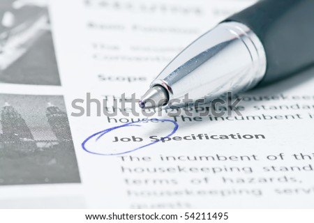 Pen Pointing at the word Job - stock photo