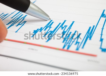 Pen pointing on a financial document
