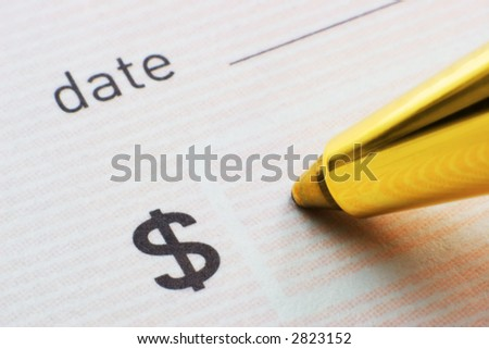 Pen ready to fill dollar field on cheque - stock photo