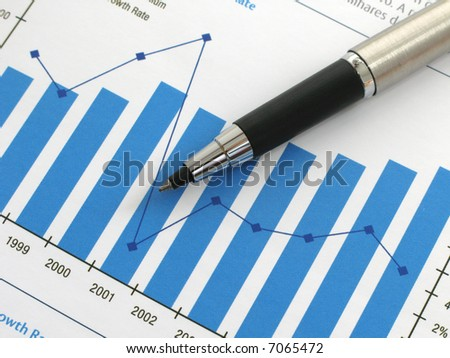 Pen showing a diagram on a report