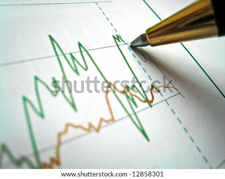 Pen showing diagram on financial report - stock photo
