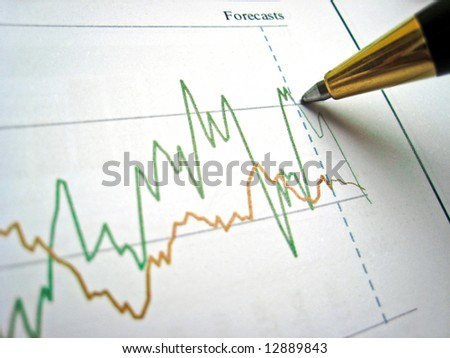 Pen showing diagram on financial report 2 - stock photo