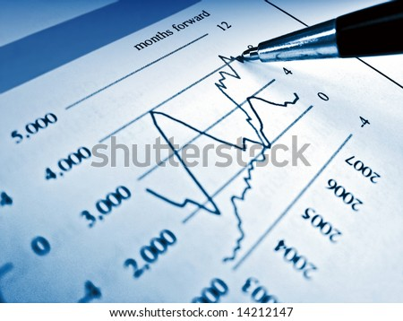 Pen showing diagram on financial report 14 - stock photo