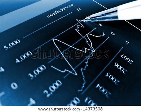 Pen showing diagram on financial report 15 - stock photo