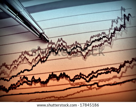 Pen showing diagram on financial report 33 - stock photo