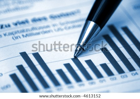 Pen showing diagram on financial report/magazine (blue tone version)