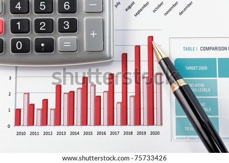 pen showing diagram on year financial report - stock photo