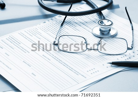 Pen stethoscope and glasses - stock photo