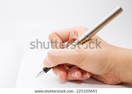 Pen was holding in hand ready to writing in note book.
