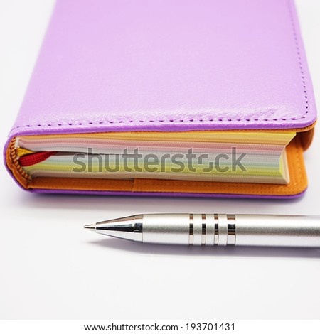 pen with book - stock photo