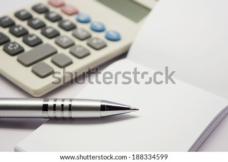 pen with books and calculators