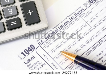 Pen with calculator over 1040 tax form top view