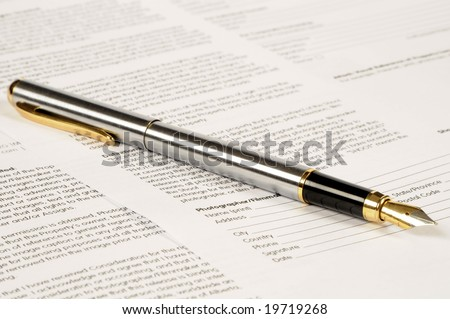 pen with gold feather on papers - stock photo
